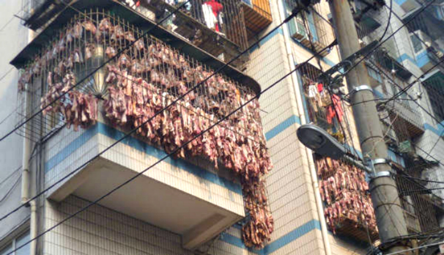 Chinese Apartment Owner Covers All of His Windows With Dangling ...