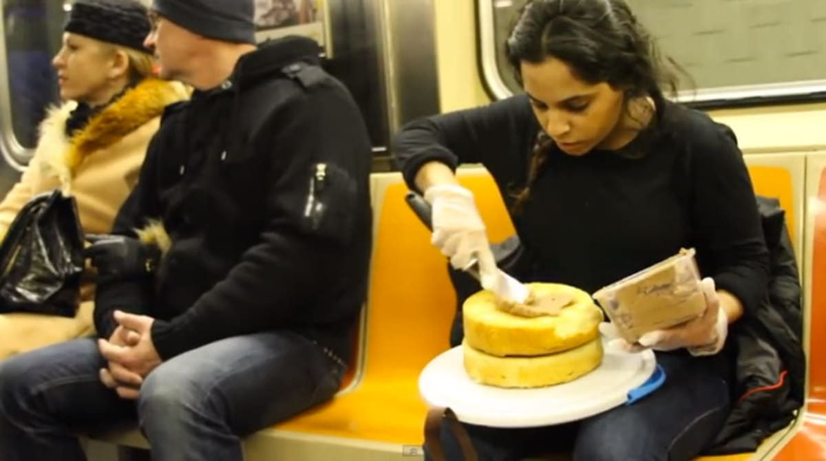 Culinary Student Ices And Serves Cake On Nyc Subway