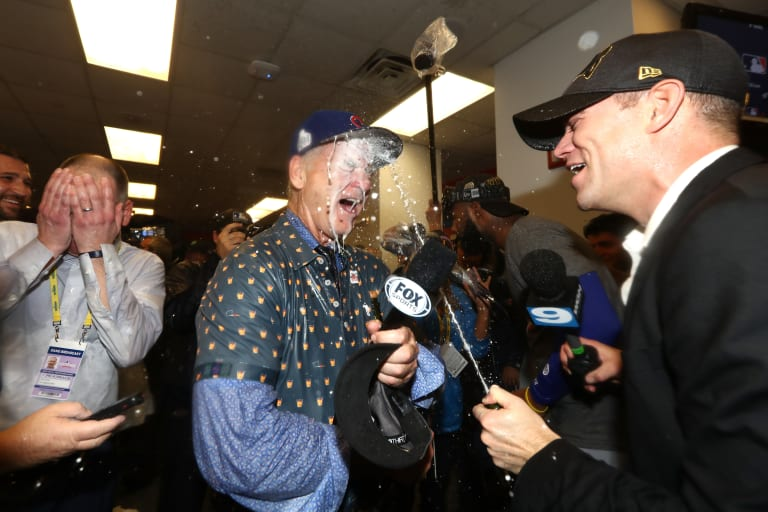 7a64de113d9 Watch Bill Murray Pour Champagne All Over the Cubs After the World Series