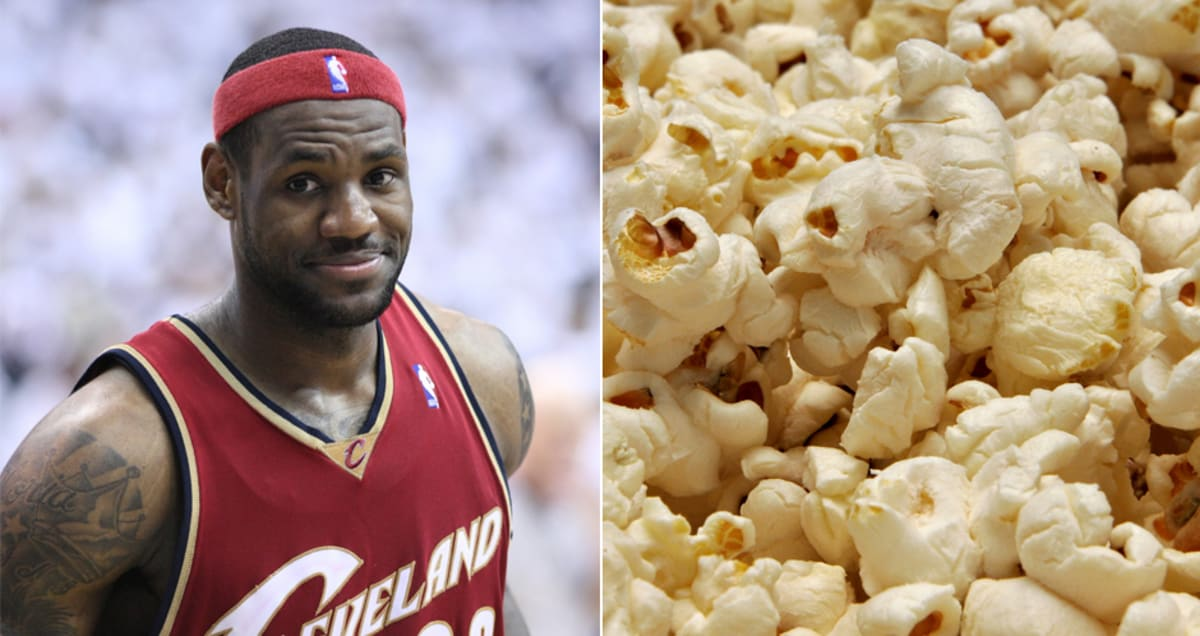 dd099e5a888 Watch LeBron James Get Caught Munching on Some Popcorn During a Game.  Champions have to eat ...